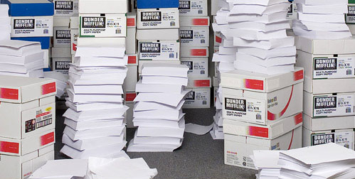 Stacks of boxes loaded up with paper from an office supply store